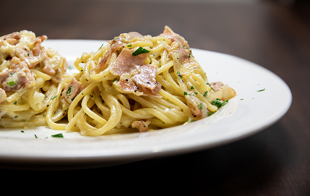 CARBONARA Pasta pancetta, egg, cheese in cream or traditional